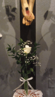 Single rose at the foot of the crucifix symbolizes the Sister who is making her profession