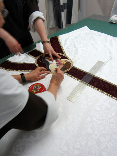 Placing the applique on the vestment