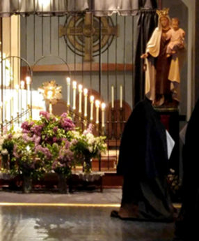 Sister adoring the Blessed Sacrament