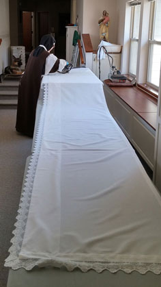 Ironing an altar cloth