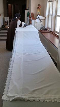 Ironing an altar cloth