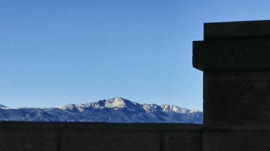 Pikes peak seen from over our enclousre wall. Finally there is snow on the peak!