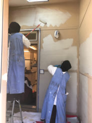 Sisters paint the walls in the new mudroom