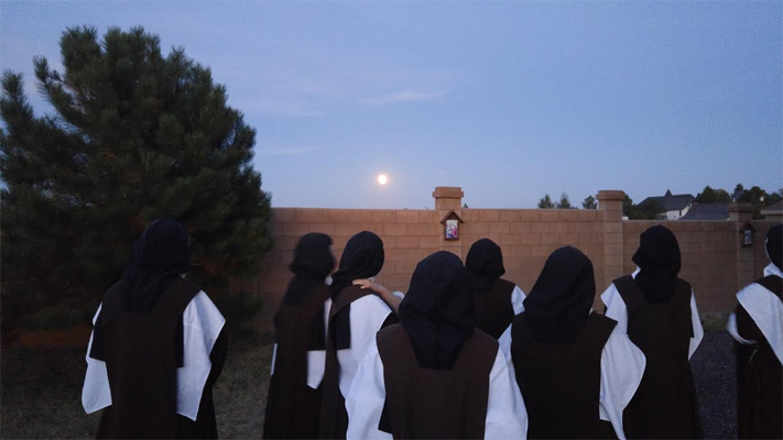 Sisters stepped out of recreation to see the lunar eclipse