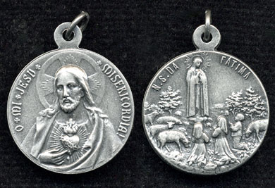 double sided medal of Sacred Heart and Our Lady of Fatima medal